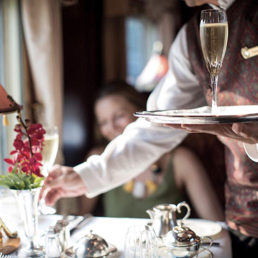 Champagne onboard on the Eastern & Oriental Express of Belmond.