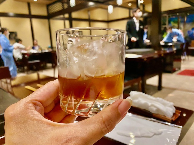 Drinking Ume shu plum wine at a traditional Japanese restaurant