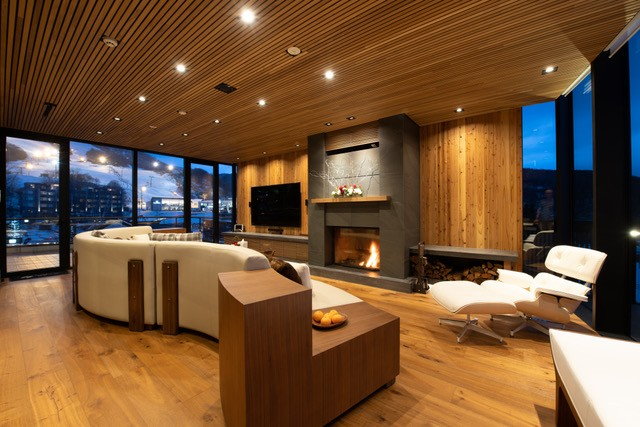 The living room has views of Mount Yotei on one side and Mount Annapurna on the other side