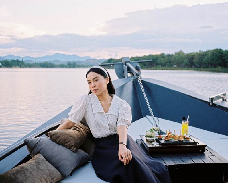 Le Ha Truc appeared on Azerai La Residence, Hue's elegant new 17-meter riverboat as it plied the Perfume River at dusk